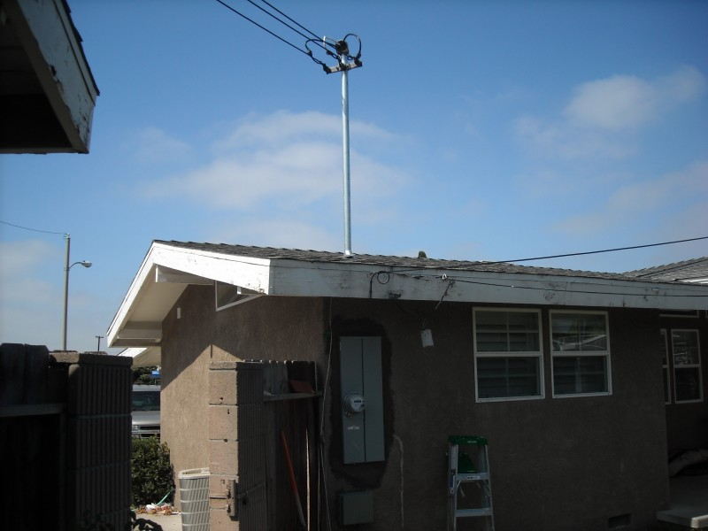 Upgrade service to 200 amp with overhead feed in Orange